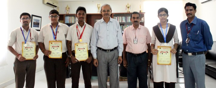 Chairman Vasireddy Vidya Sagar Dean Dr.N.Kumara Swamy congratulating the students